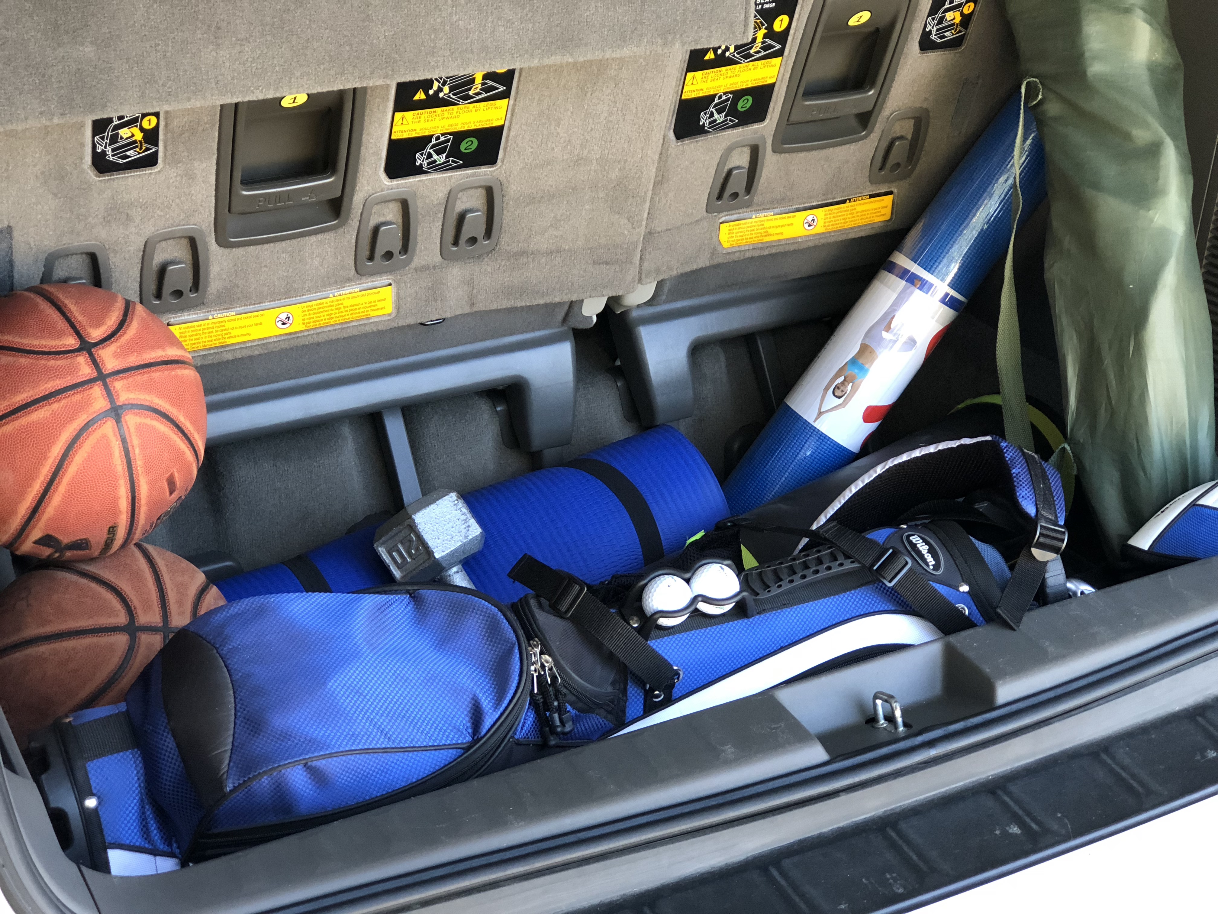 simple tips to save money on gas – trunk filled with sports gear