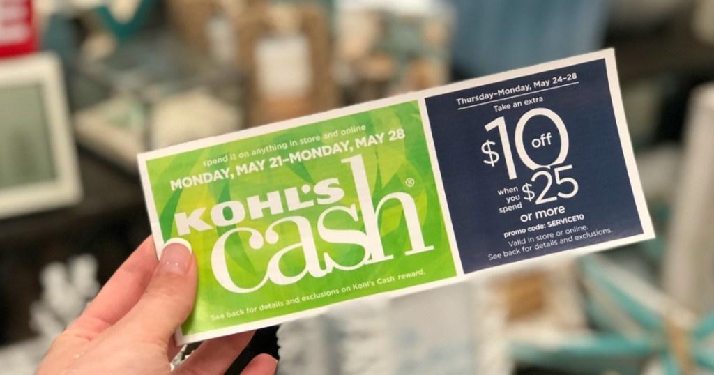 hand holding kohl's cash