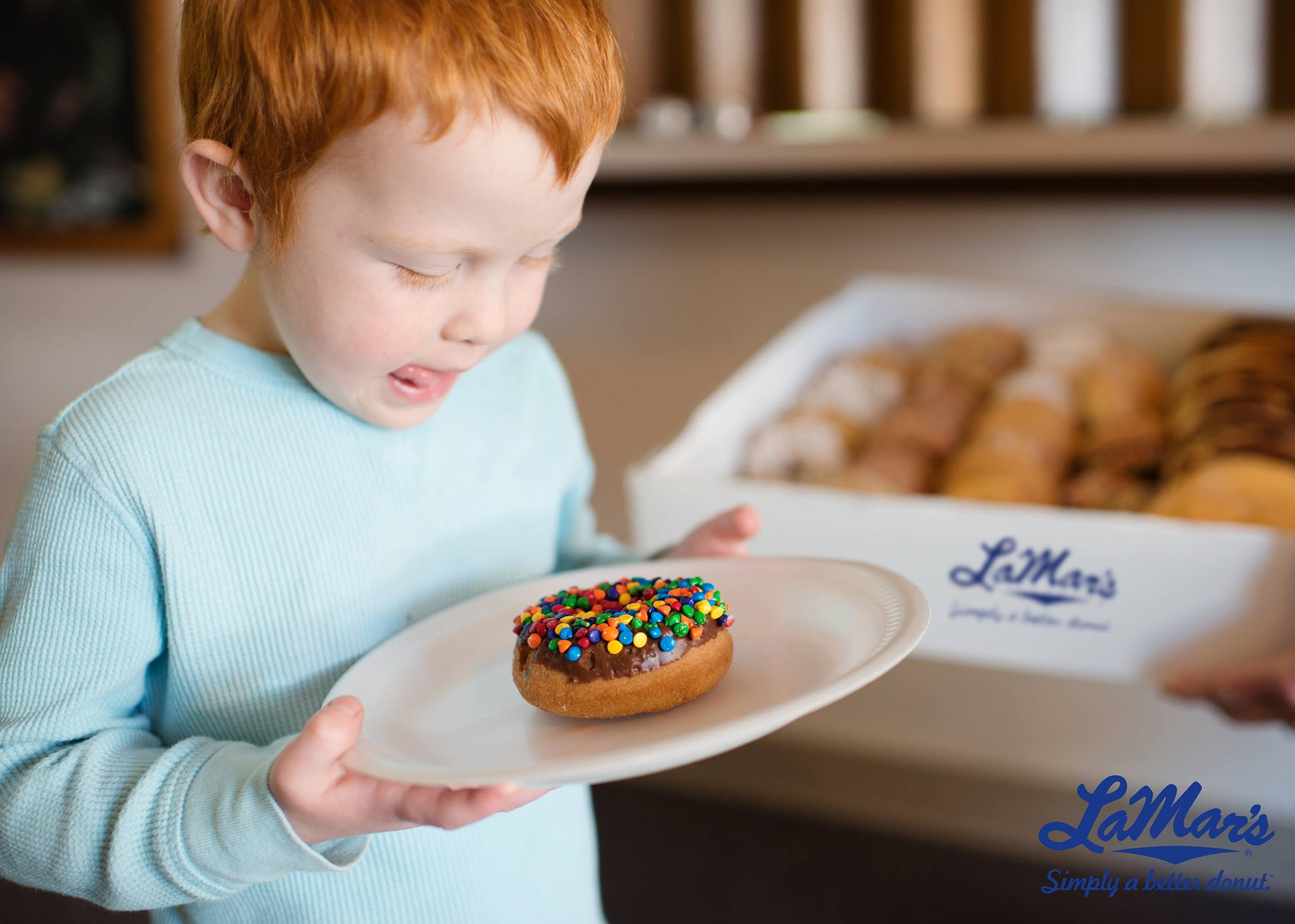 2018 national doughnut day freebies – child with lamar's donut