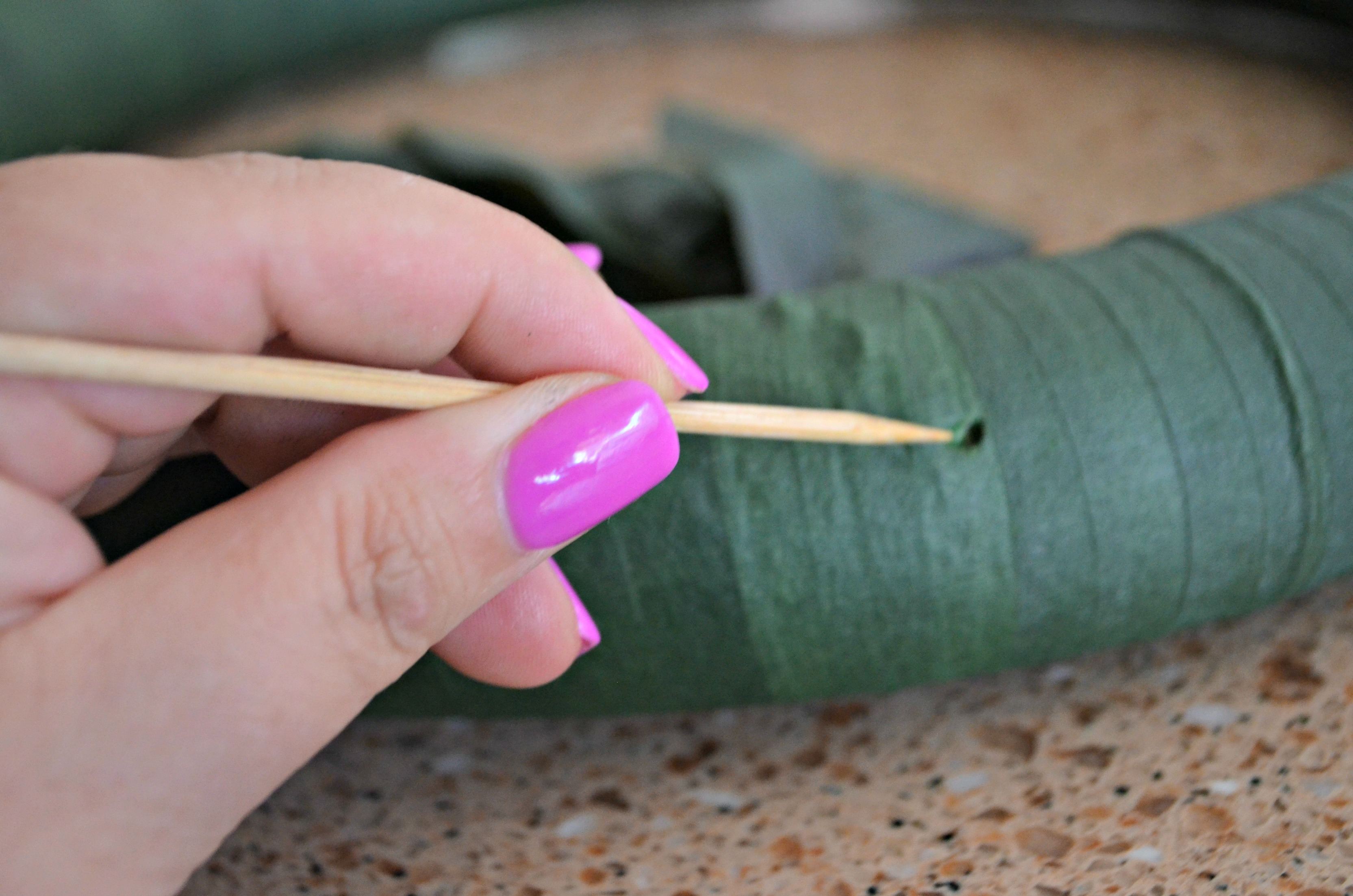 Poke a hole where leaves will go for better adhesion.