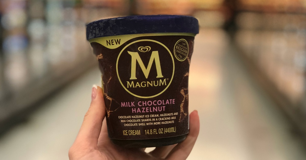 hand holding container of magnum ice cream