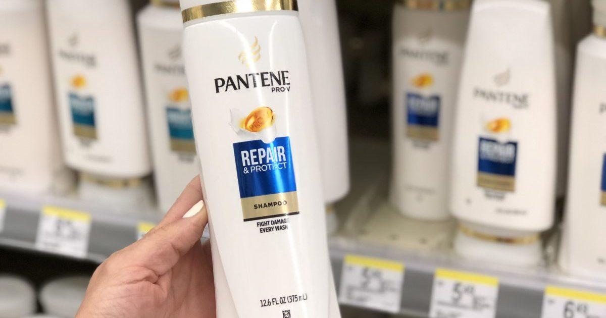 pantene shampoo in hand