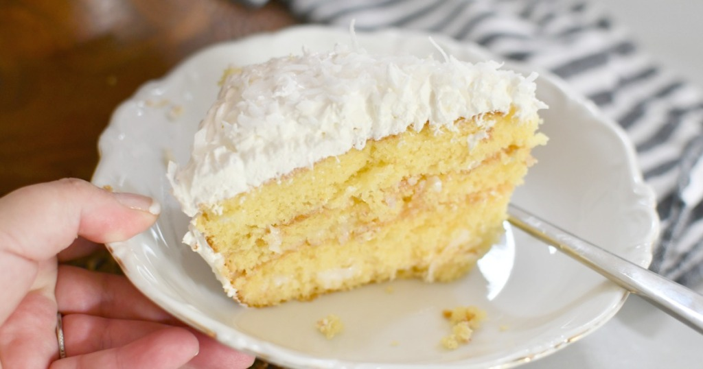 plate with a slice of coconut sour cream cake