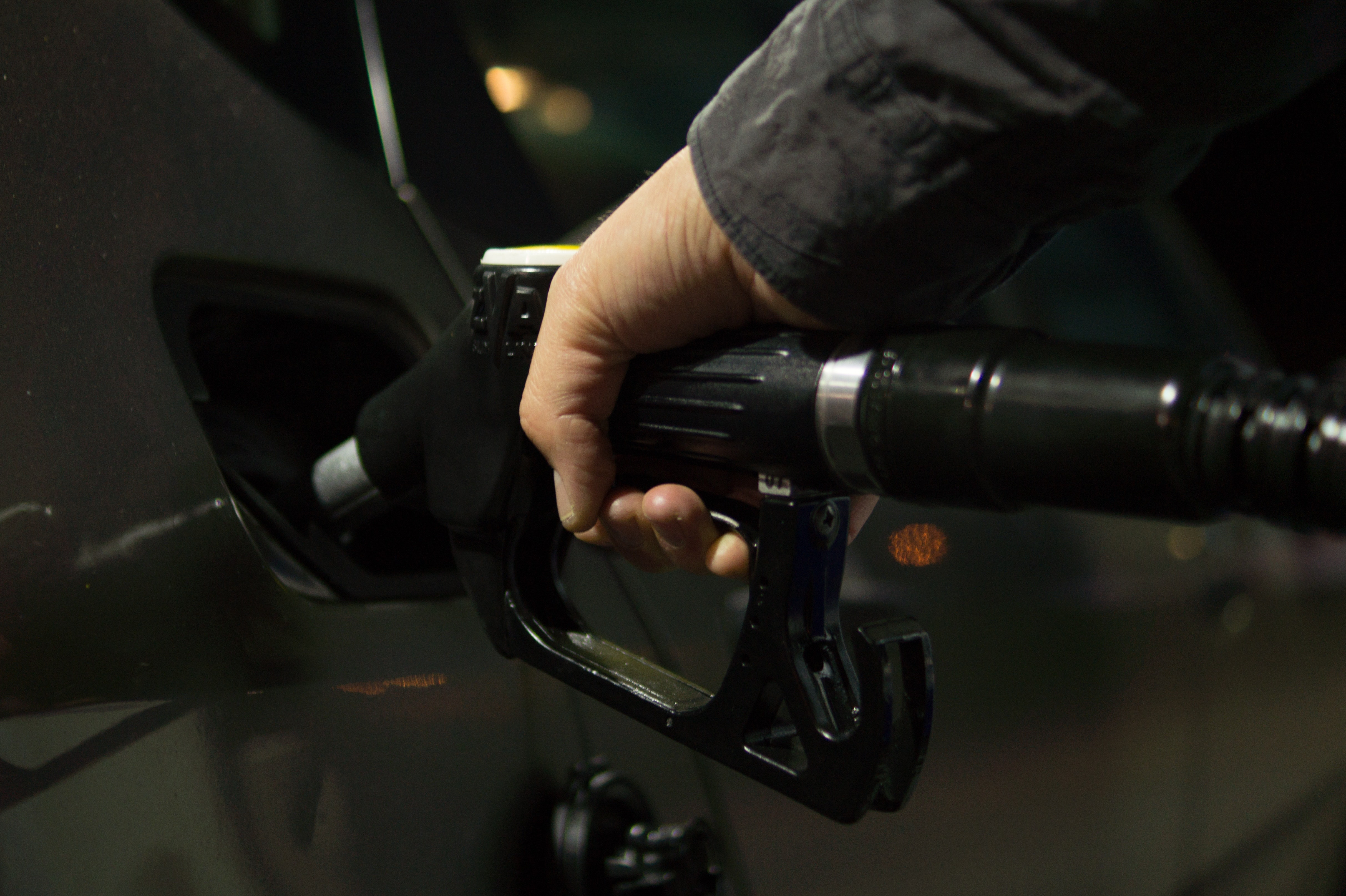 simple tips to save money on gas – gas nozzle in a gas tank