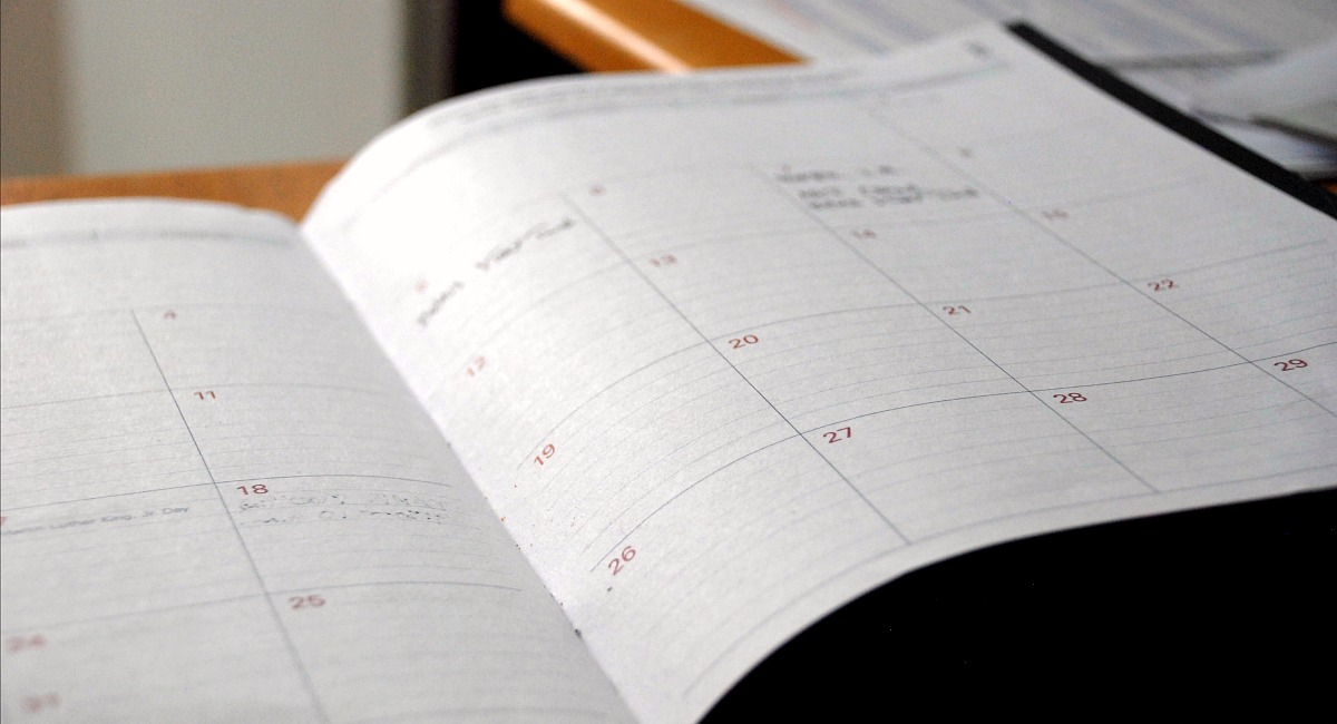 writing in calendar notebook