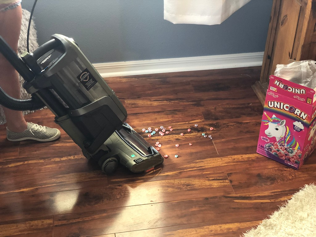 Shark APEX DuoClean vacuum review – cleaning up cereal on a wooden floor