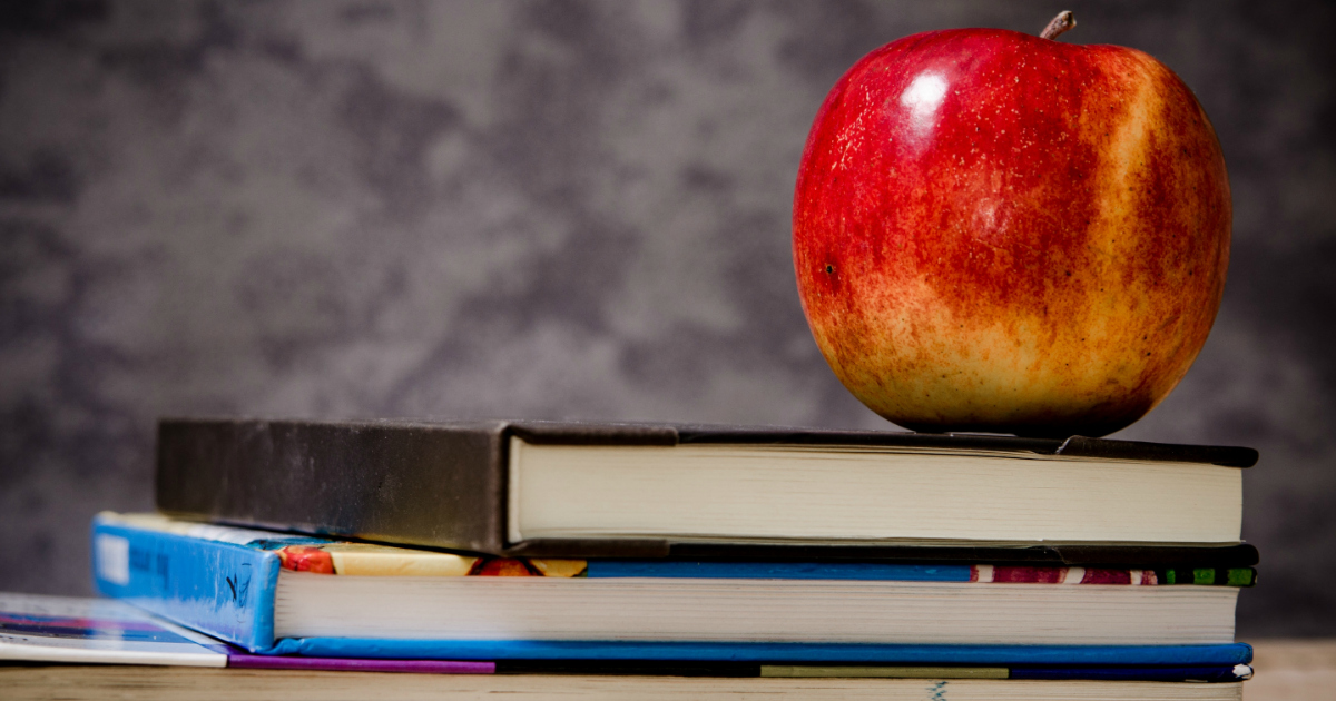 Teachers looking for discounts, we've got you covered – books and an apple
