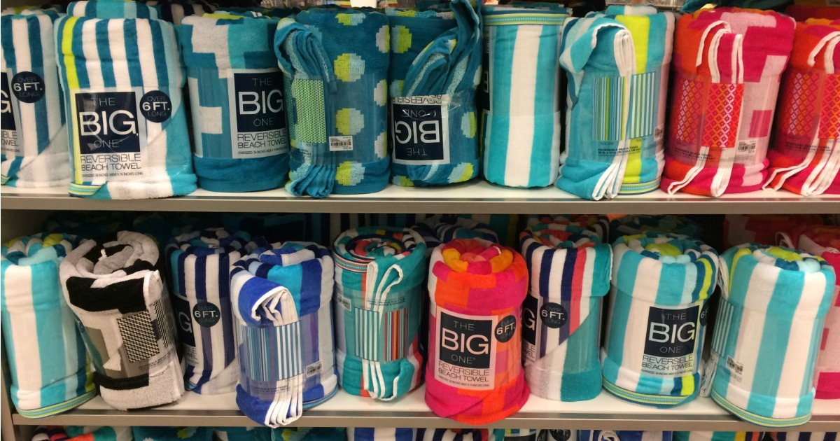 reversible beach towels on a shelf in a store