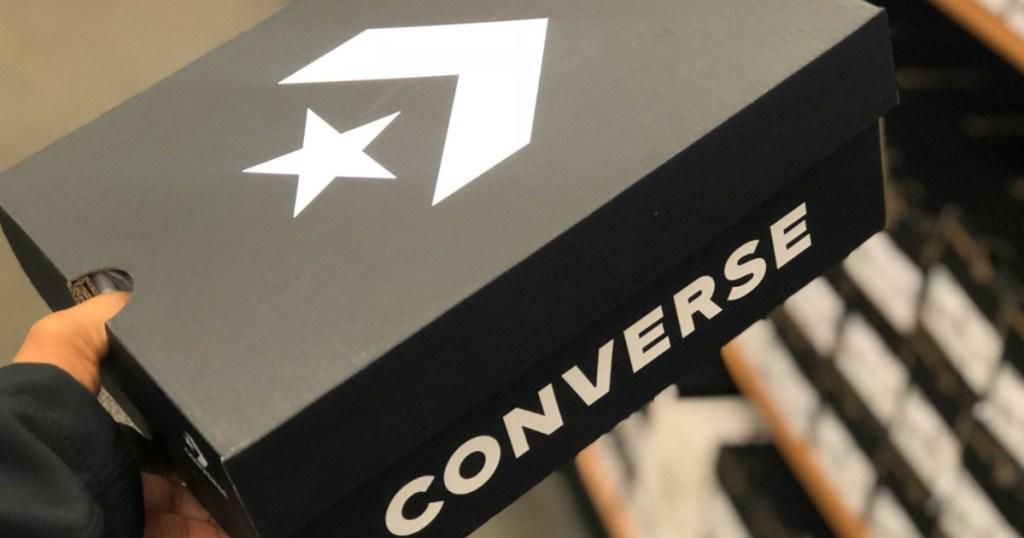 hand holding converse box