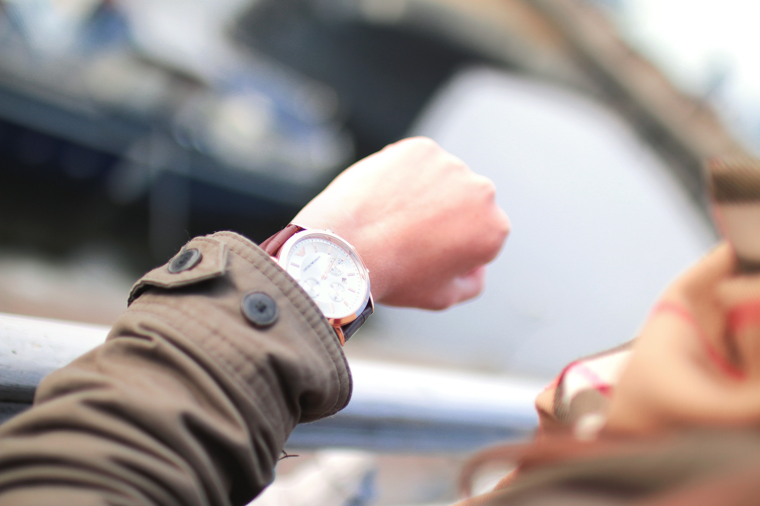 simple tips to save money on gas – woman looking at her watch