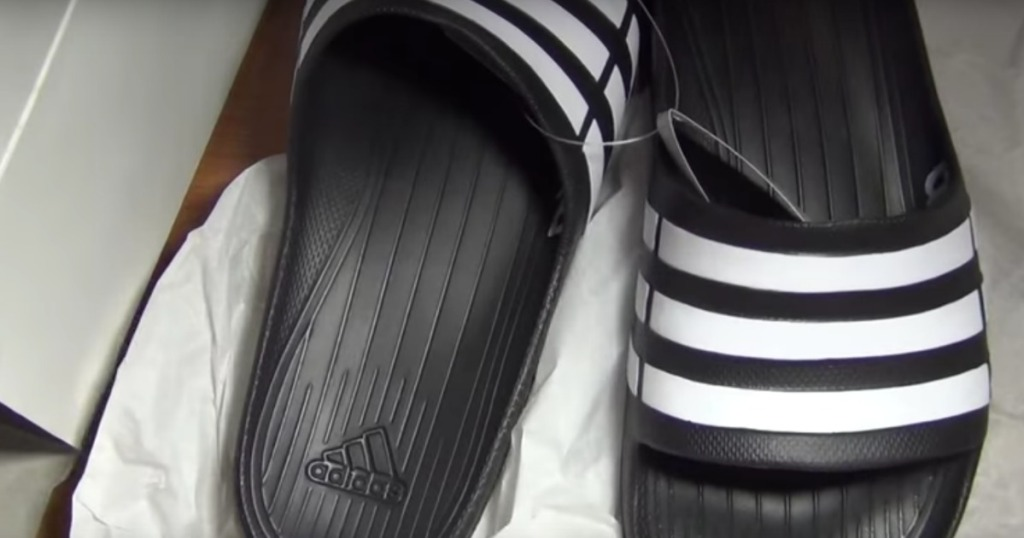 black and white adidas slides in show box