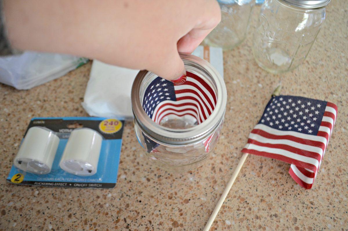 Dollar Tree 4th of July Craft Mason Jar Votives – using mini flags as a backdrop