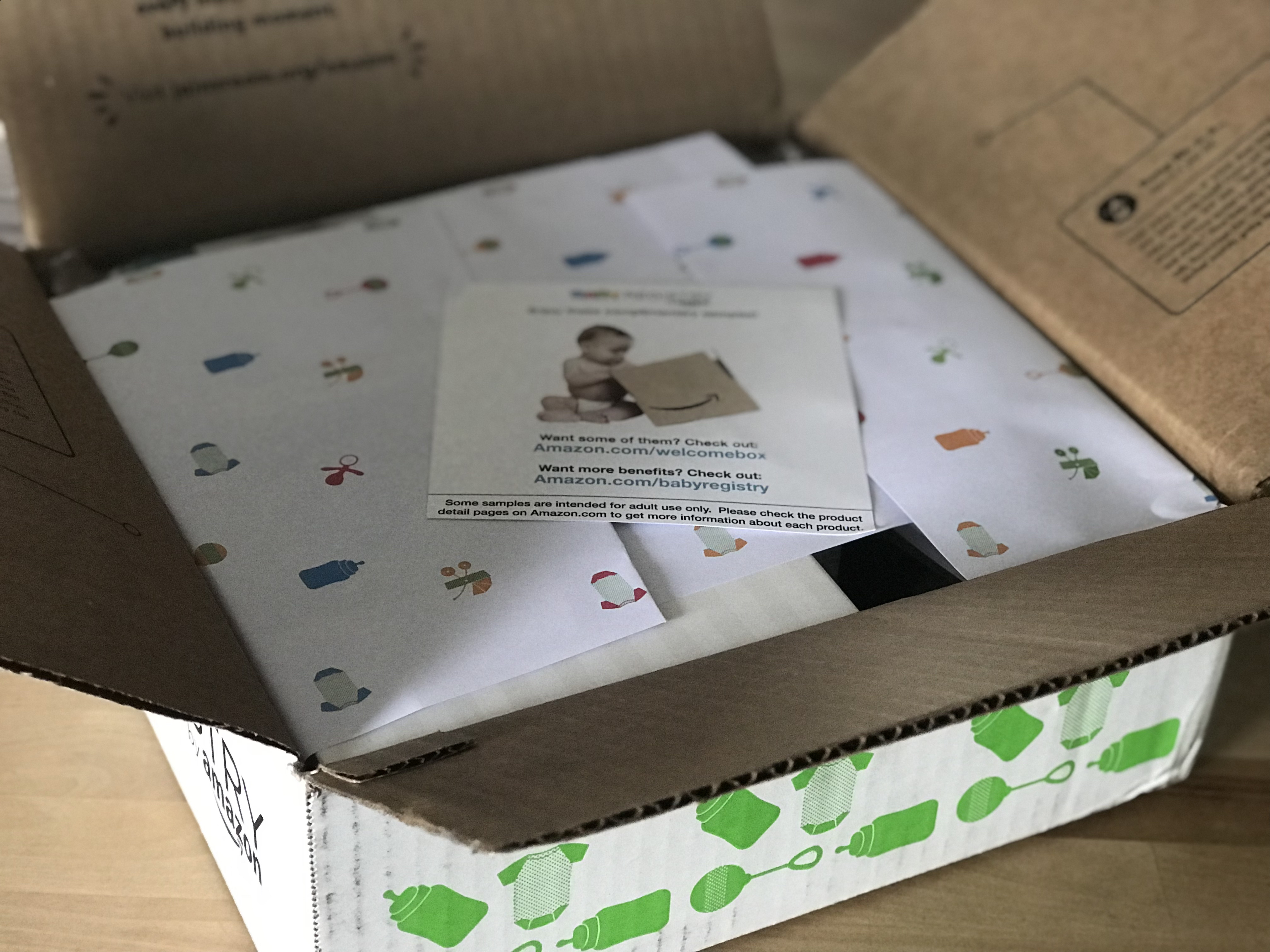 free amazon baby welcome box - Box opened, with wrapping and a welcome card on top