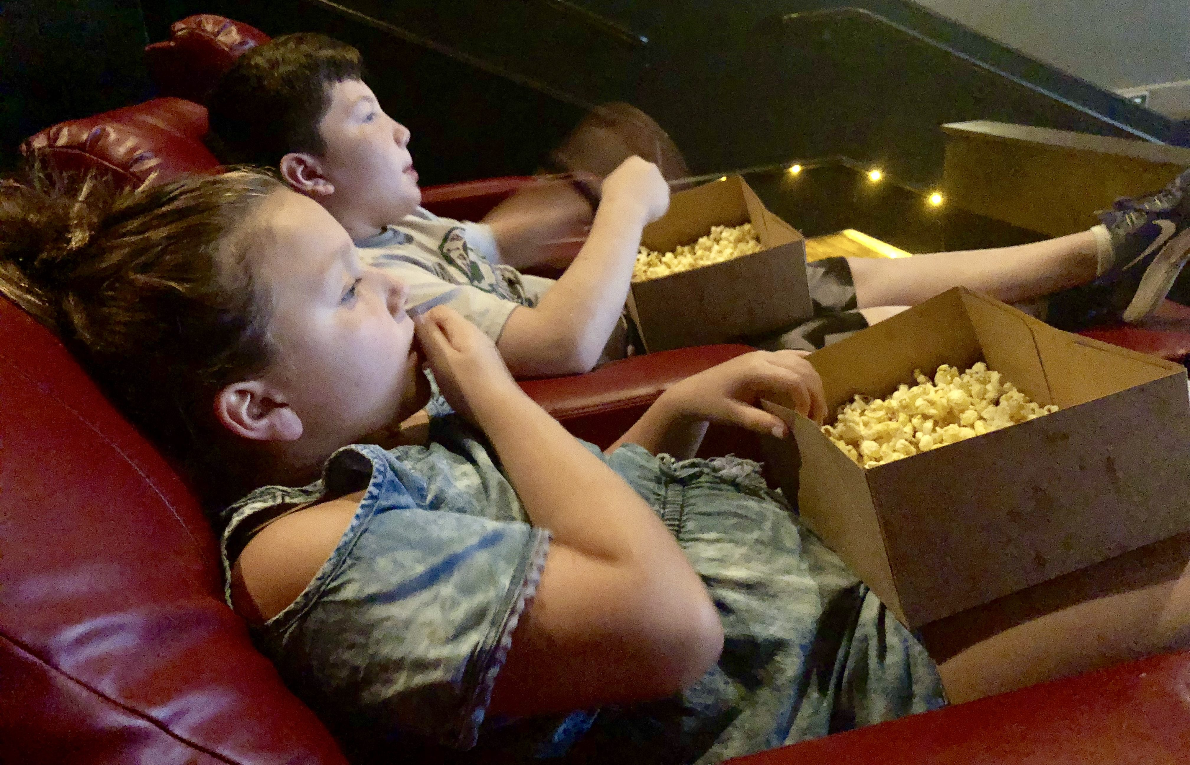 movies amc launching subscription moviepass - kids watching a movie