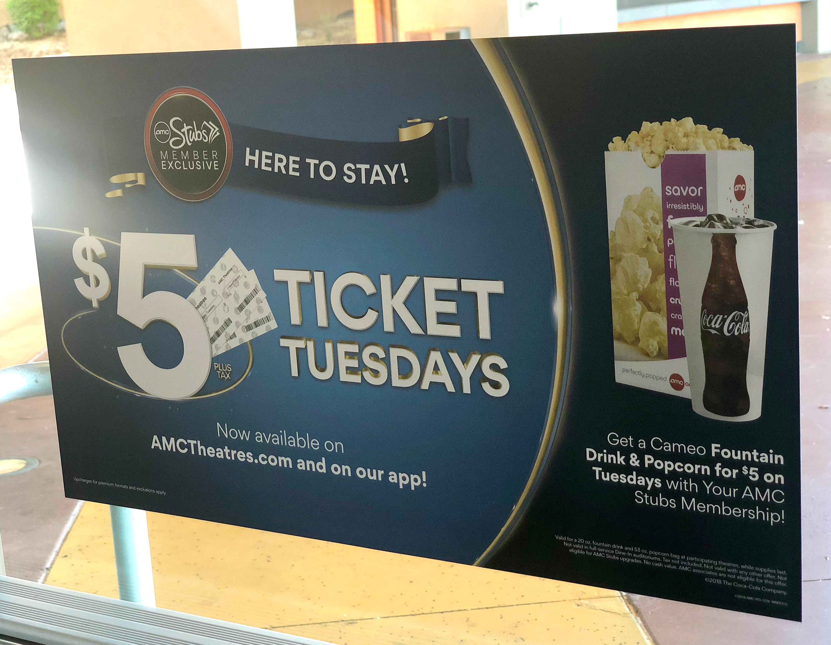 simple movie theater hacks that save money - AMC Ticket Tuesday sign