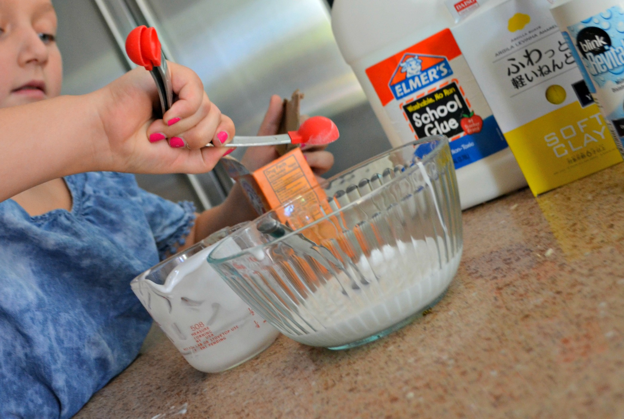 Make diy butter slime using clay – Putting ingredients together