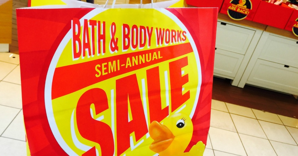 Holding Bath & Body Works Semi-Annual Sale bag