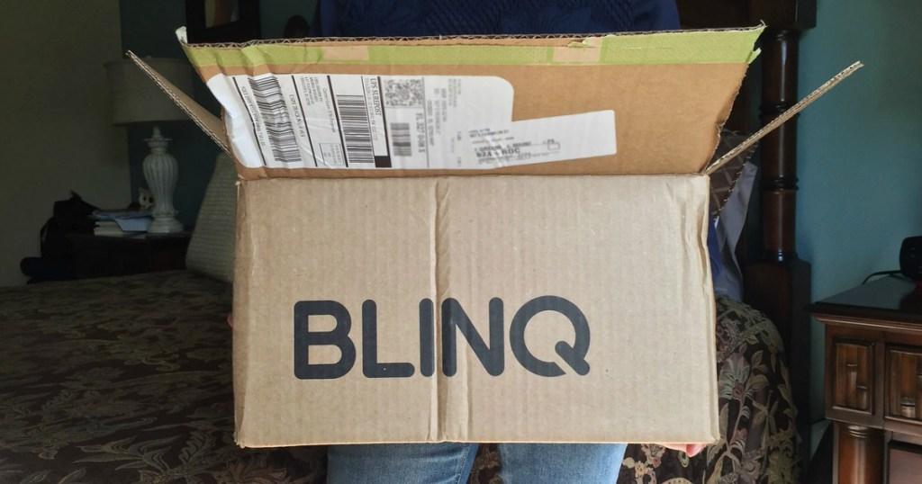 Woman holding Blinq.com box