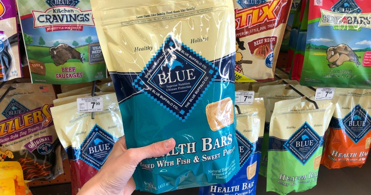 hand holding blue dog treats