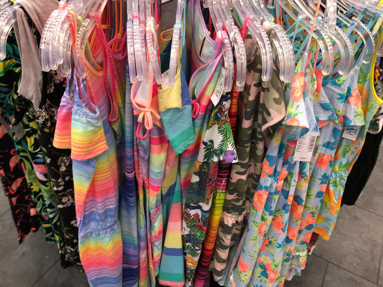 girls dresses on a rack in-store