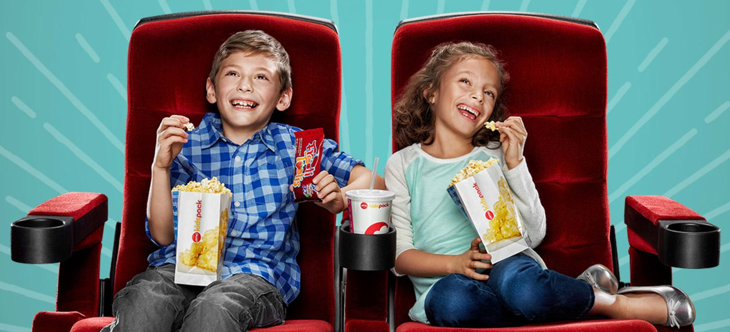 discounted kids summer movie offers – boy and a girl watching a film