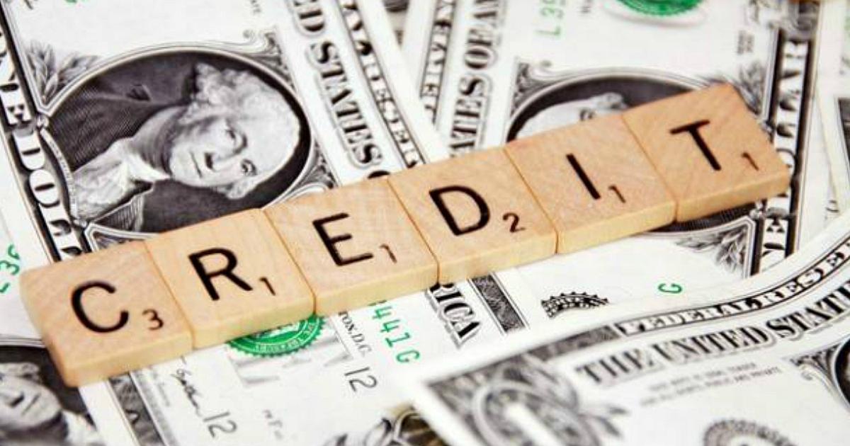 "Scrabble tiles that read ""Credit"""
