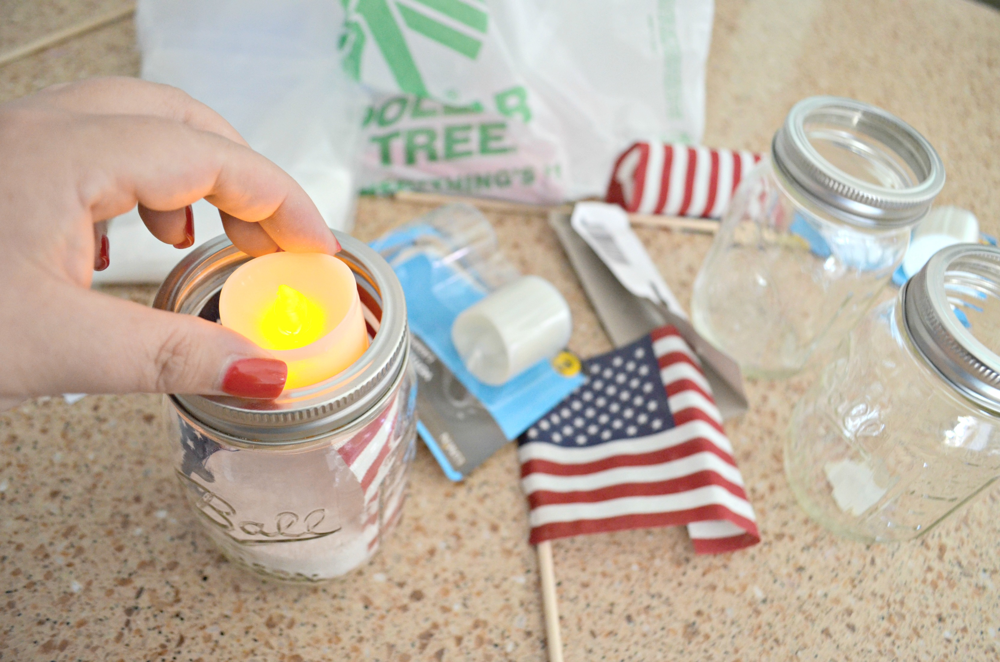 Dollar Tree 4th of July Craft Mason Jar Votives – adding flameless candles
