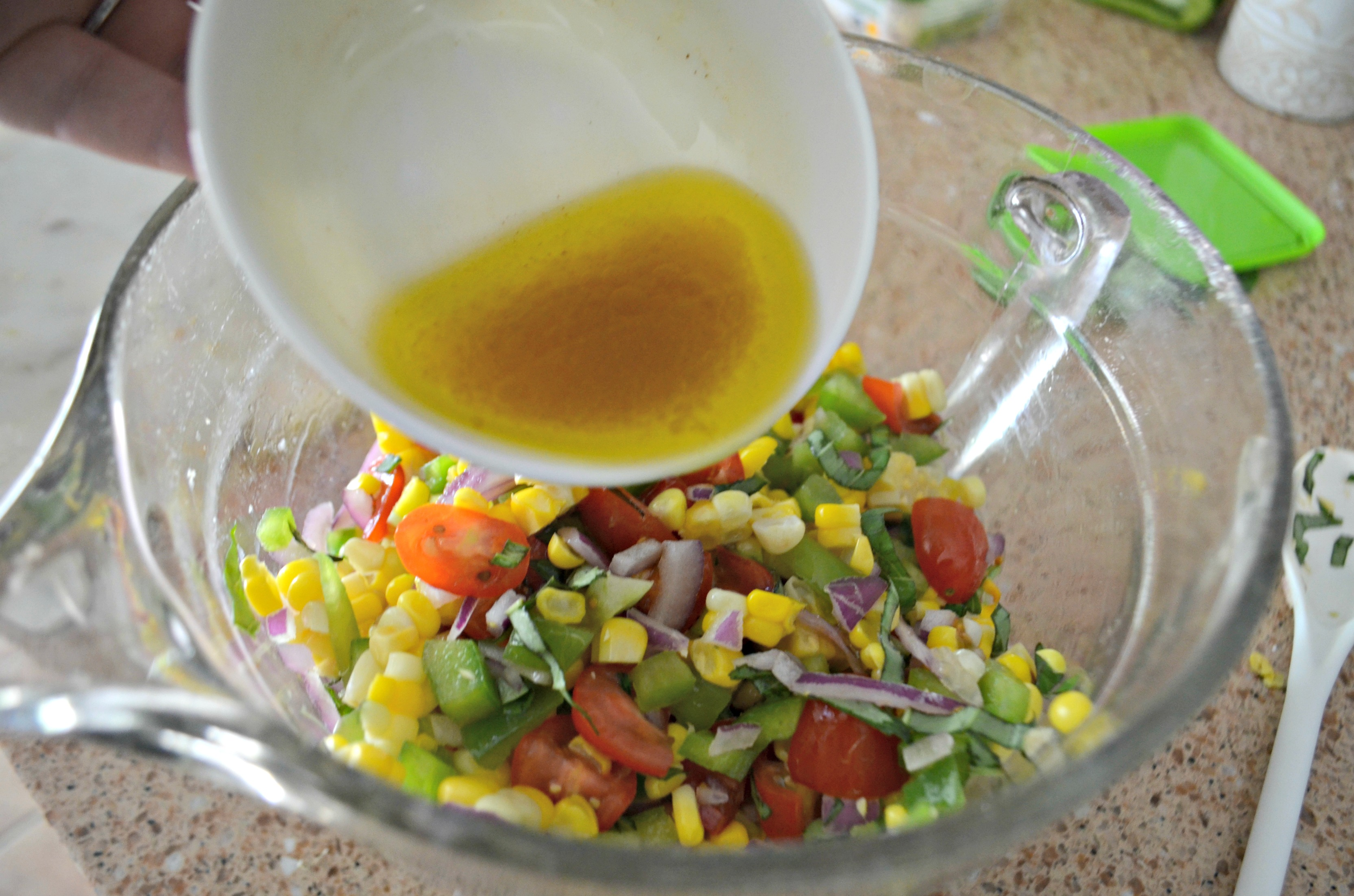 Easy Fresh Summer Corn Salad – adding the dressing to the ingredients