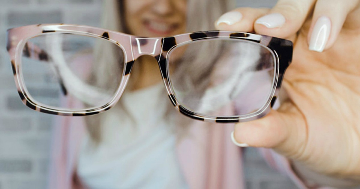 GlassesShop.com glasses being held by a woman