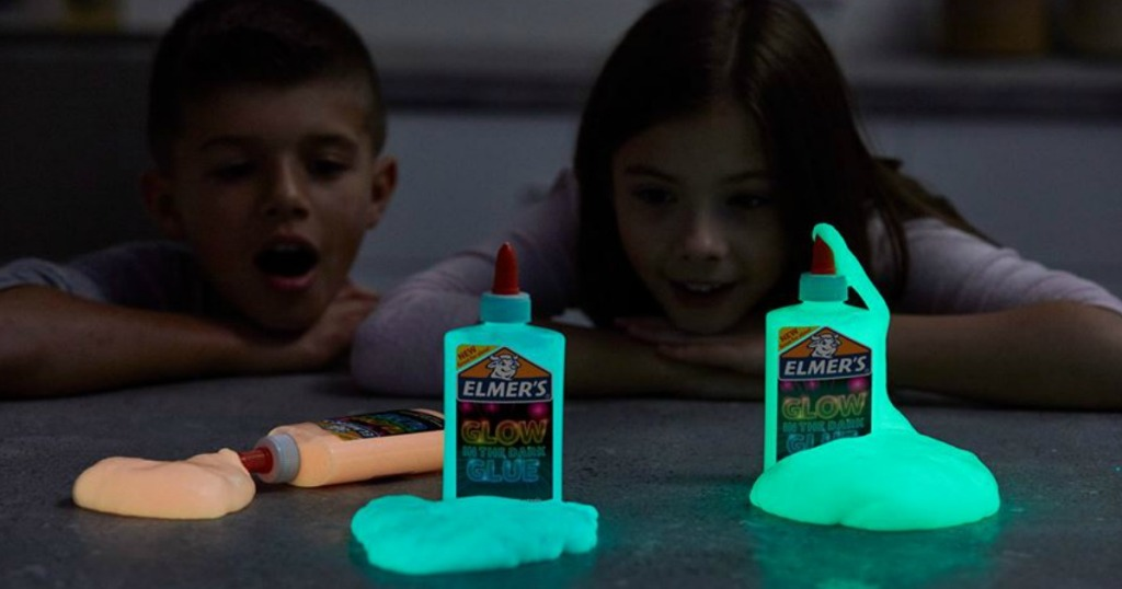 boy and girl looking at glow in the dark slime