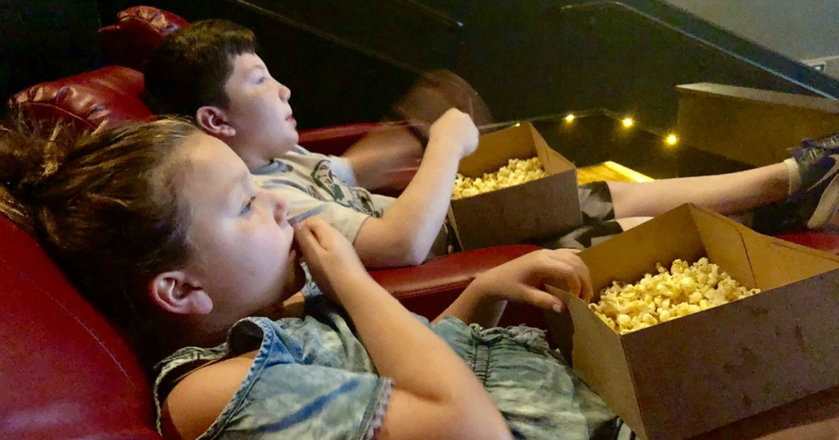 kids in movie theater eating popcorn