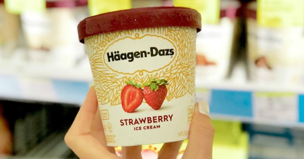 hand holding Haagen-Dazs ice cream