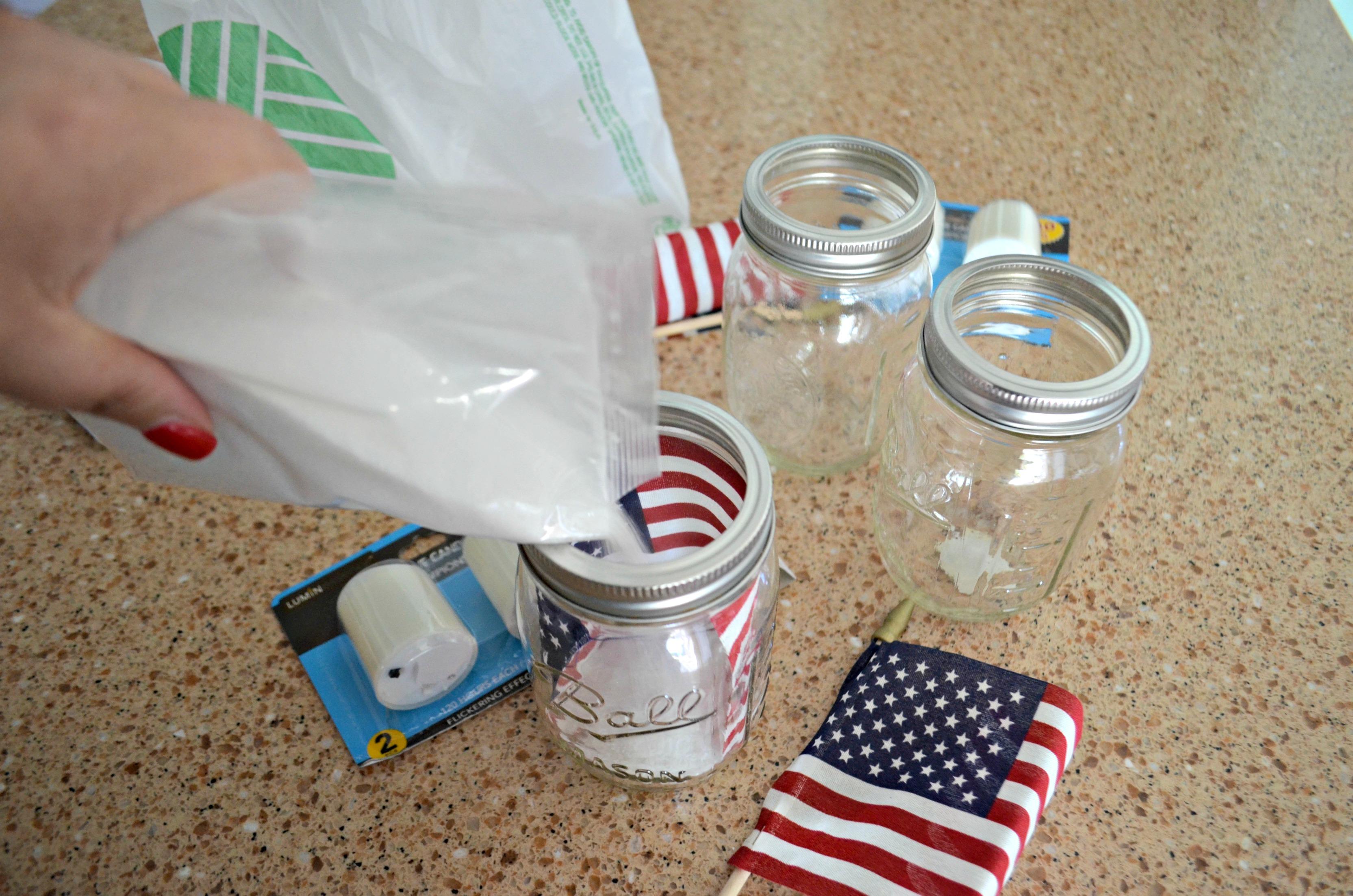 Dollar Tree 4th of July Craft Mason Jar Votives – filling jars with sand