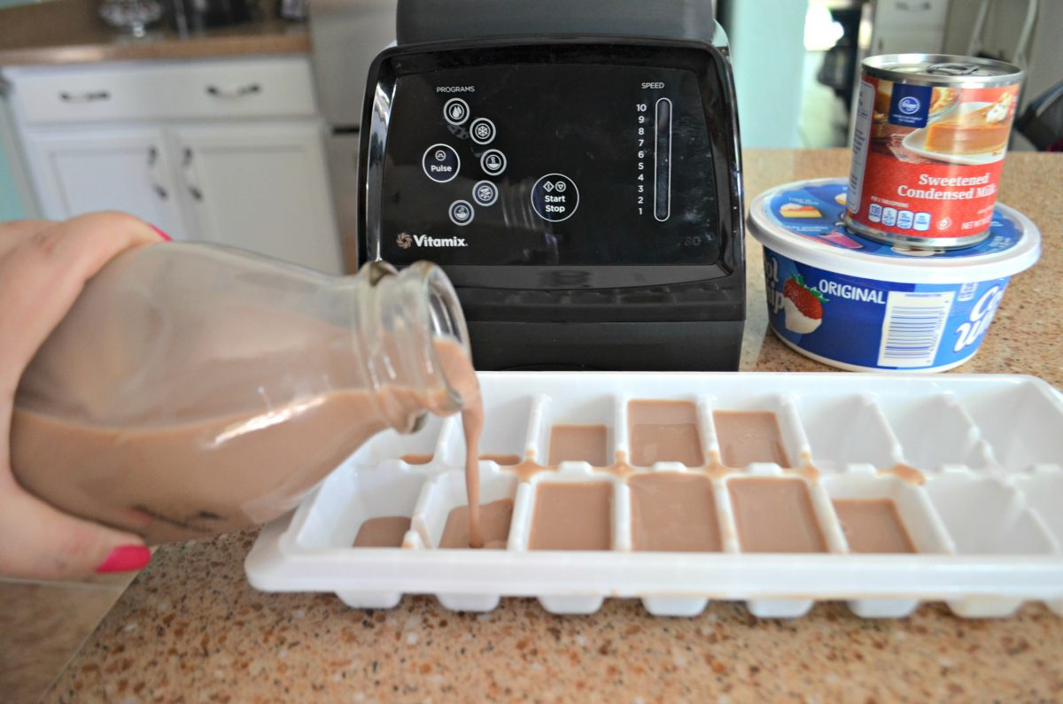 easy copycat Wendys frosty recipe – Pouring chocolate milk into an ice cube tray