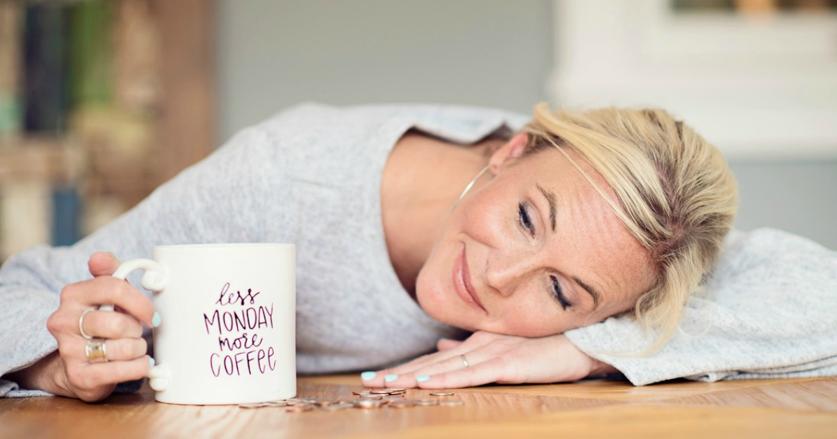 Vacation budget hacks to book the best deals — Collin looking at her coffee mug dreamily