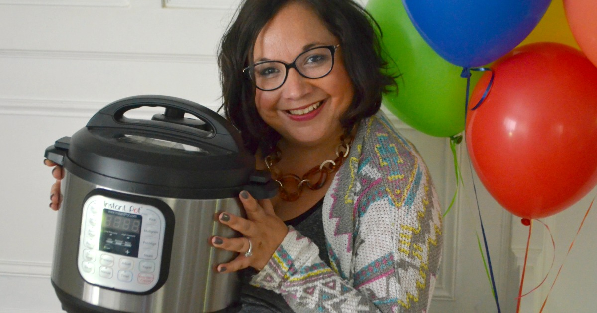 Hip2Save's Top 10 Recipe & DIY Posts of All Time –– Lina holding her instant pot