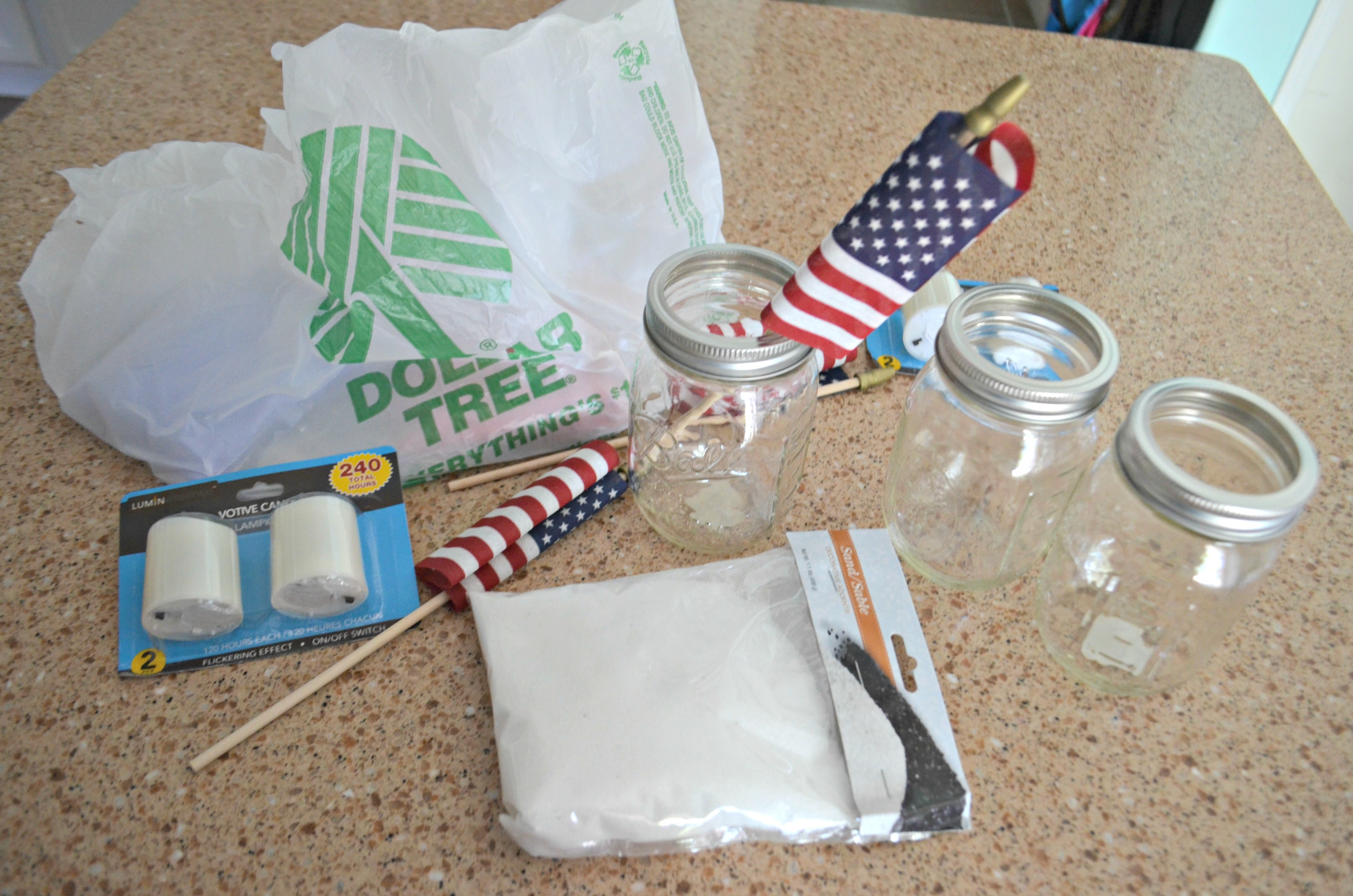 Dollar Tree 4th of July Craft Mason Jar Votives – supplies laid out on the counter top