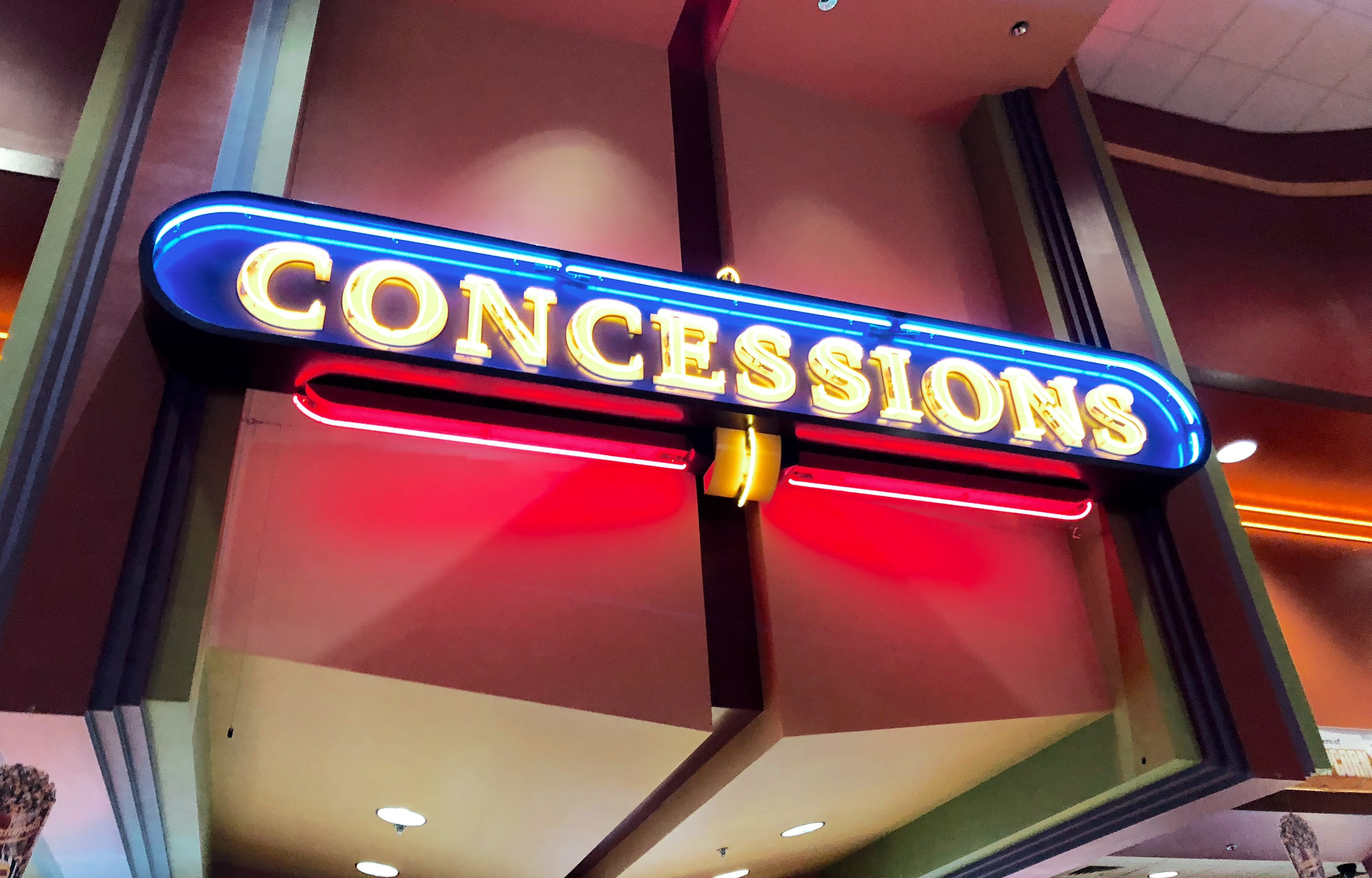 simple movie theater hacks that save money - movie concessions sign