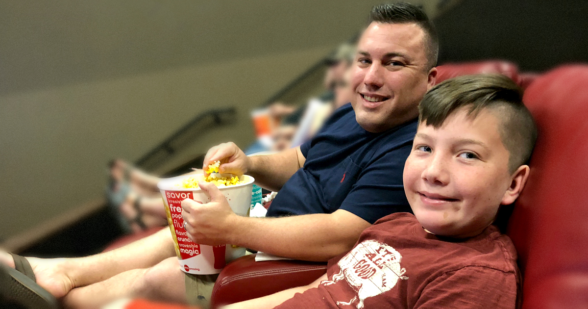 simple movie theater hacks that save money - a happy family at the Movies