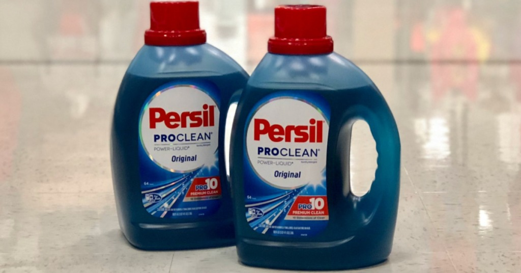 Two large bottles of Persil brand laundry detergent in-store on the floor