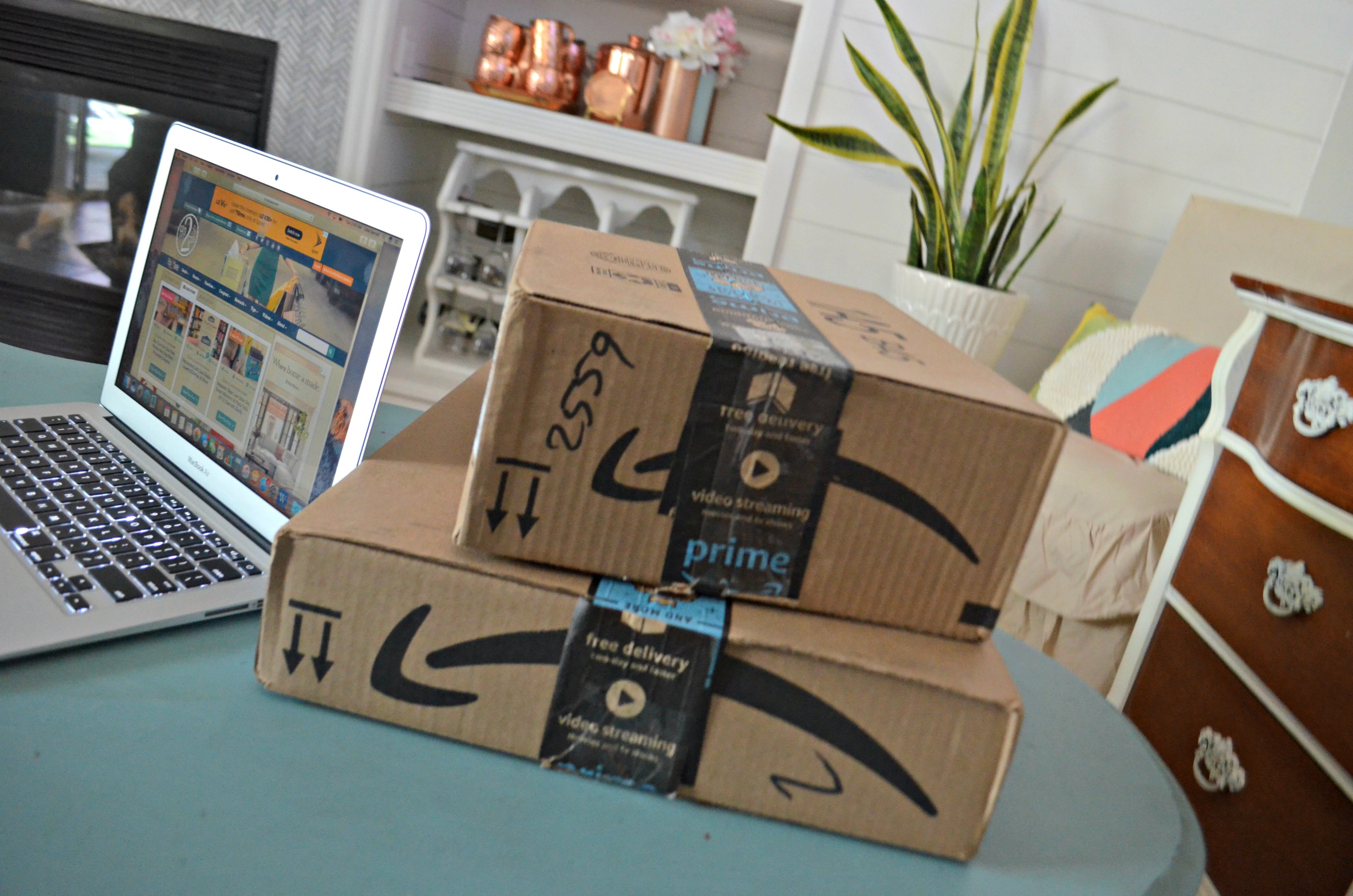 amazon prime day deals | Amazon boxes stacked on a table