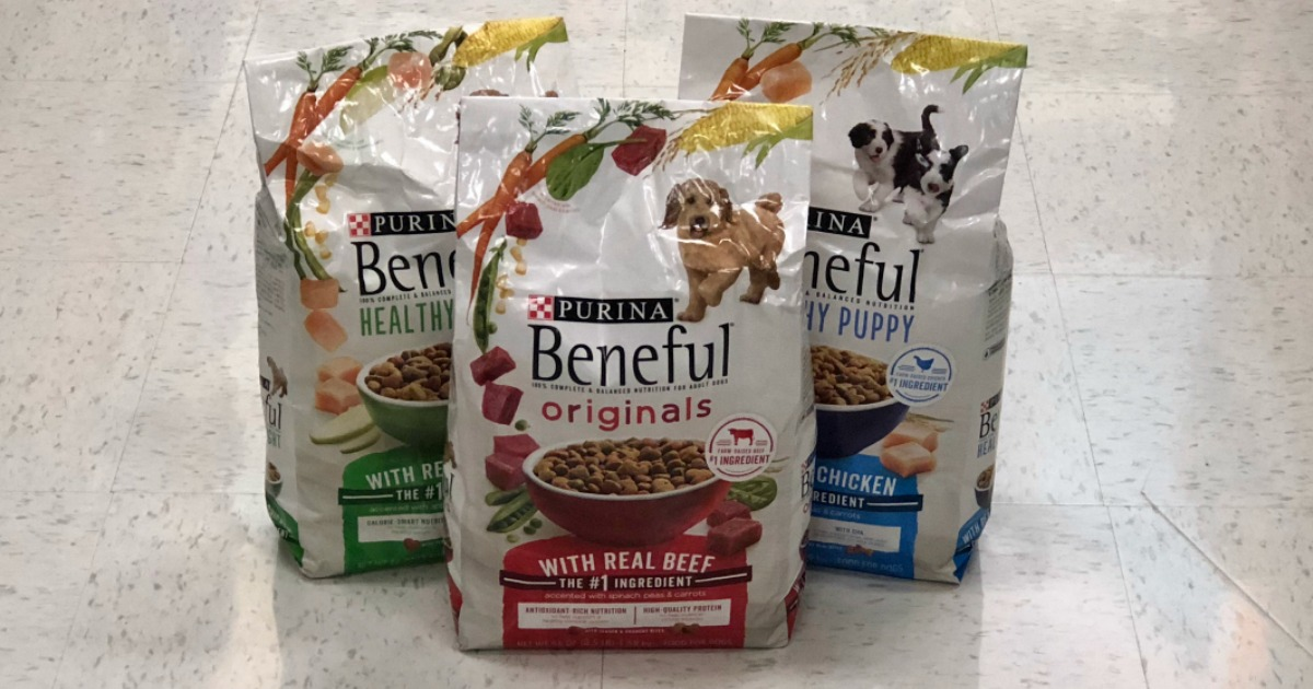 three bags of Purina Beneful dog food sitting on a store floor