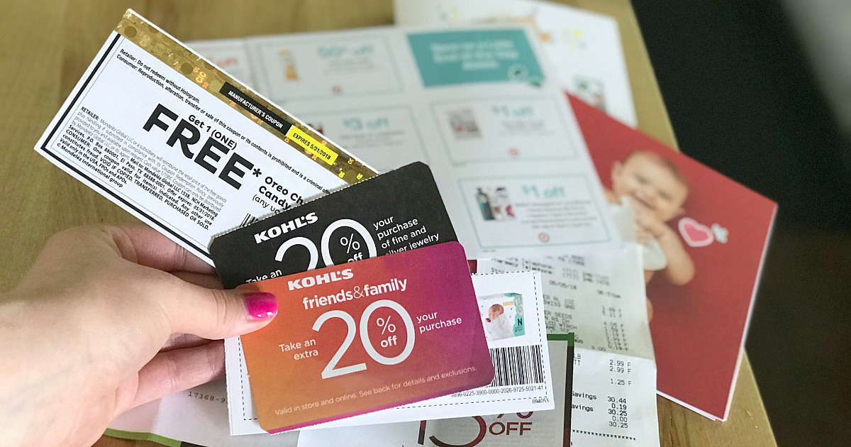 Hand holding store coupons
