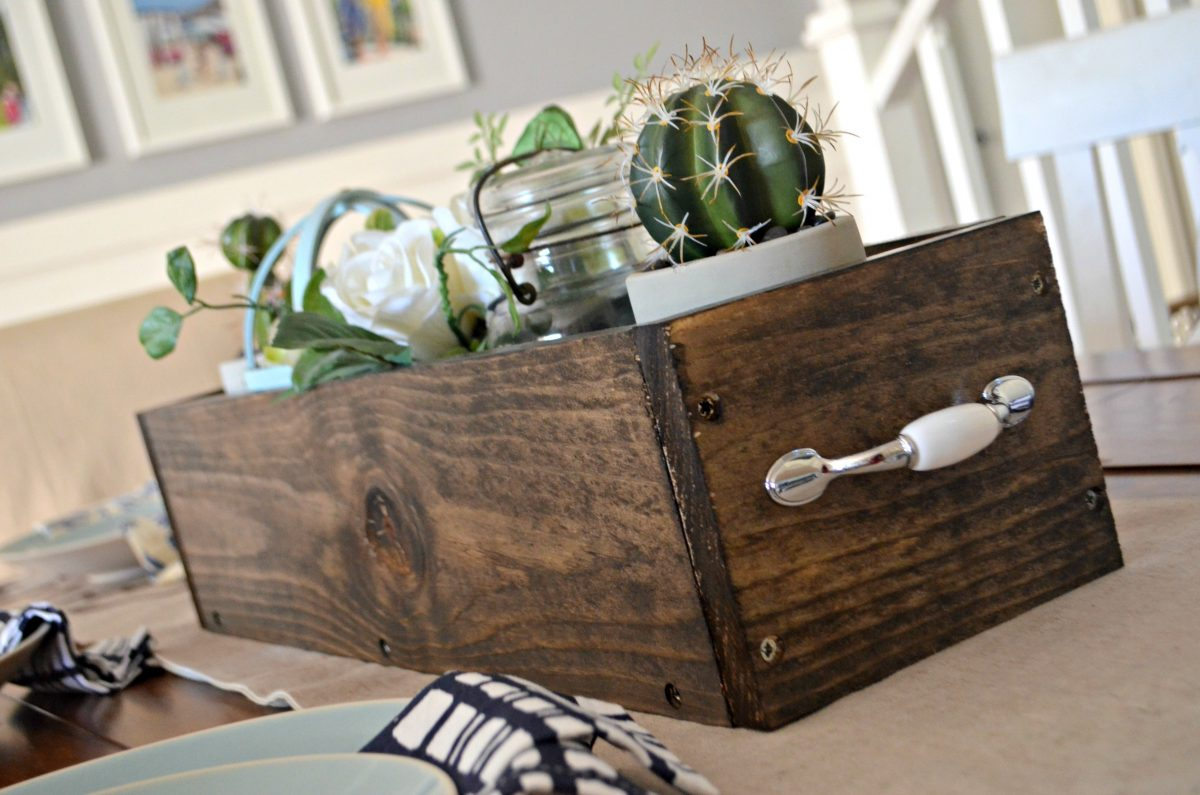 diy rustic farmhouse wood box centerpiece – decorated with a cactus, flowers, and a candle