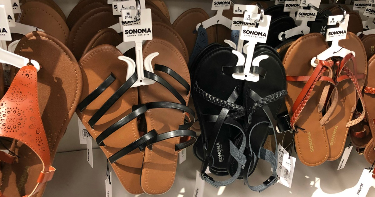 womens strappy sandals on a store wall display