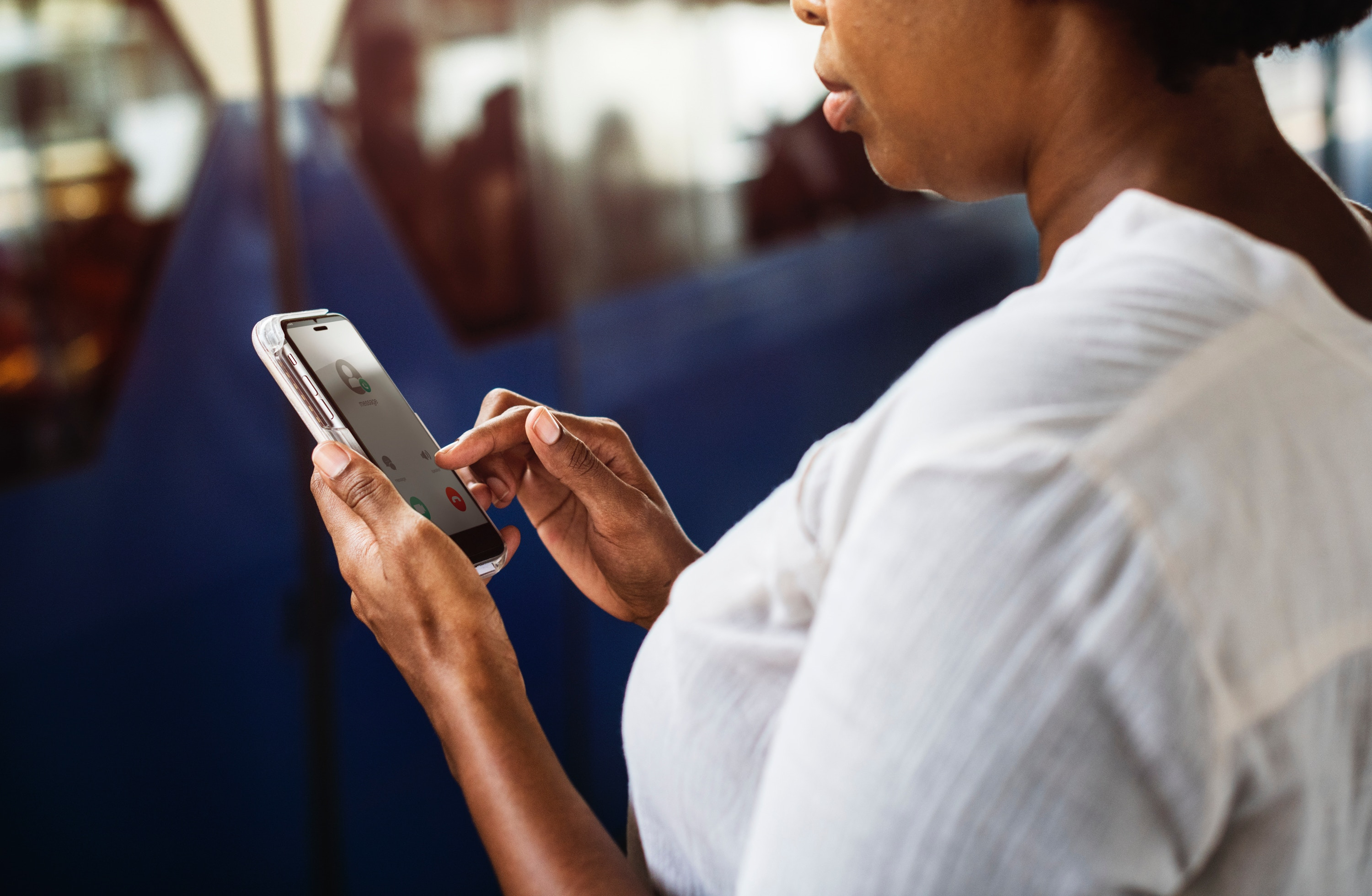 stop unwanted spam phone calls – woman considering whether to answer the phone