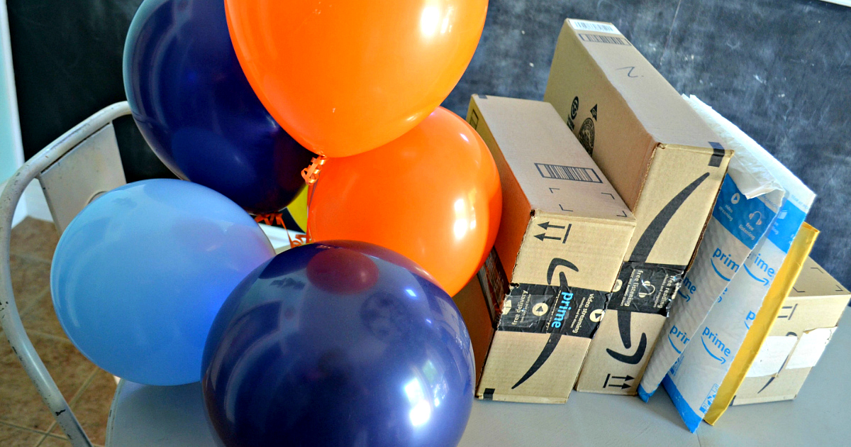 win a membership just in time for amazon prime day - balloons and Amazon boxes