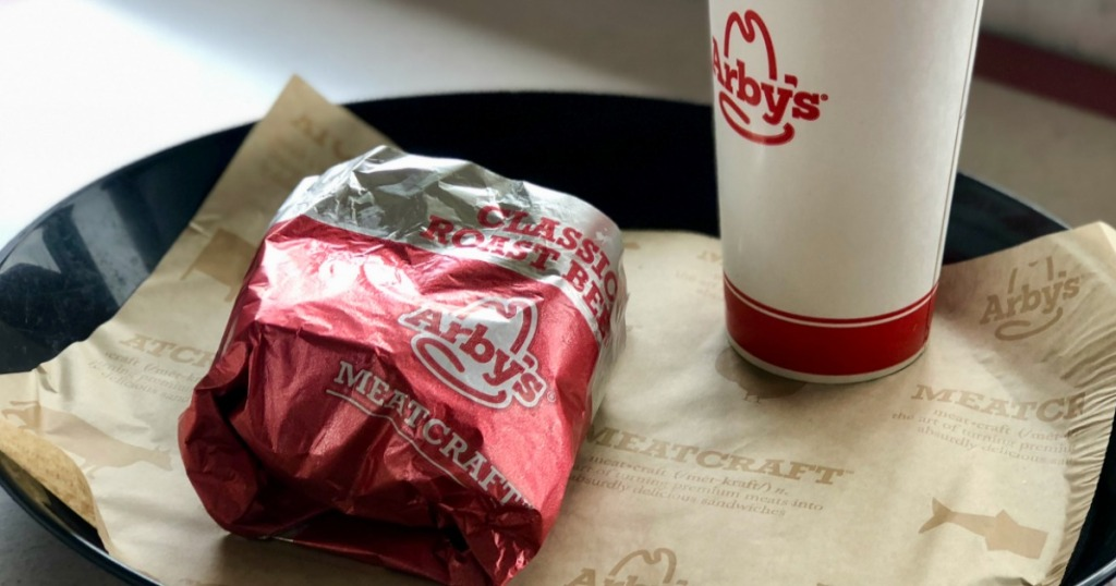Arby's sandwich with drink on tray