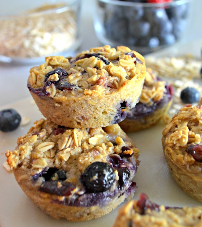 Baked Oatmeal Berry Cups – the finished muffins stacked on a plate
