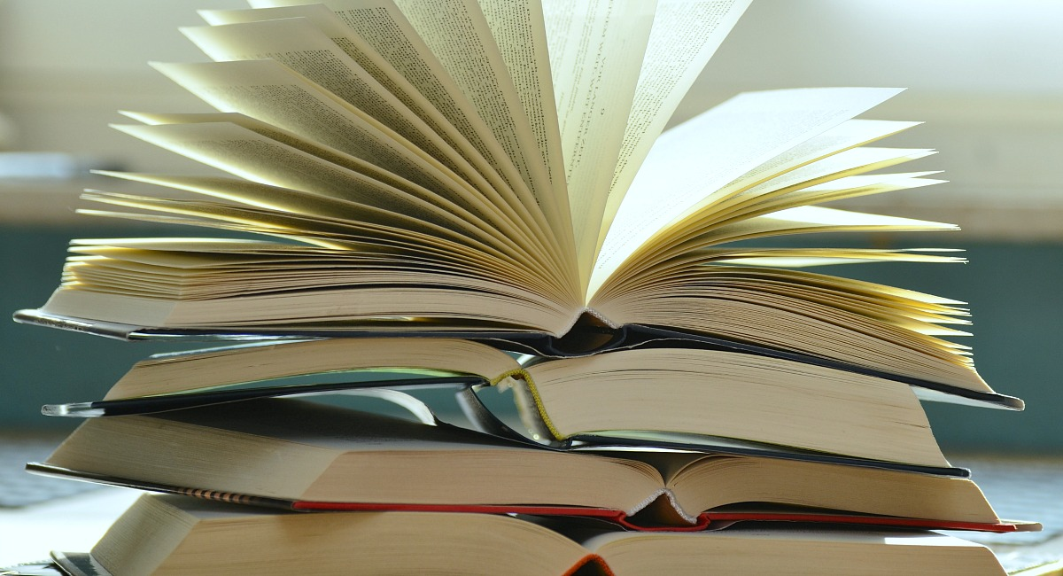 moving hacks to save money — books opened up on table